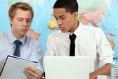 Two young adults preparing student presentation — Stock Photo