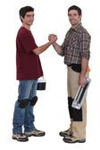 Two manual workers greeting each other — Stock Photo