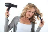 Woman drying hair — Stock Photo
