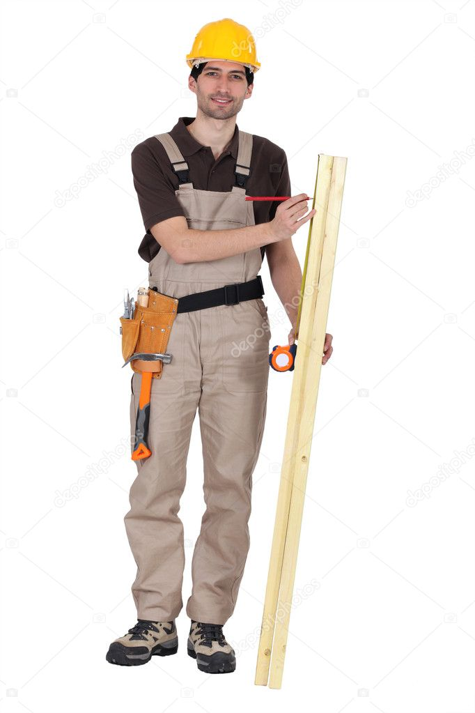 Man measuring wood — Stock Photo #10344258