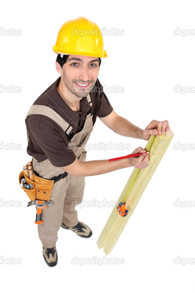 Carpenter marking wood — Stock Photo #10344334