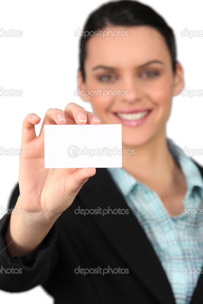Woman all smiles holding business card — Stock Photo #10345860