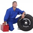 Mechanic changing a tire — Stock Photo #10376917