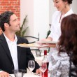 Waitress serving customers — Stockfoto #10377211