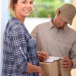 Woman receiving package — Stock Photo #10377234