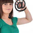 Girl holding an @ sign — Stock Photo #10377629