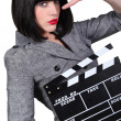 Stock Photo: Take two: Girl with a film clapperboard