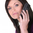 Woman talking on her mobile phone — Stock Photo #10377859