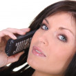 Stock Photo: Brunette making telephone call
