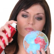 Womspraying miniature globe — Stock Photo #10377933