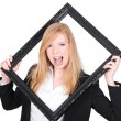Young woman holding a black frame — Stock Photo