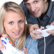 Stockfoto: Playing video game console