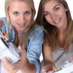 Teenage girls playing computer games — Stock Photo