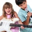 Little boy and girl playing musical instruments - 