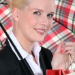 Stock Photo: Portrait of a woman under umbrella