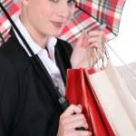 Portrait of a woman under umbrella — Stock Photo