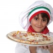 Little Italian girl presenting a pizza — Stock Photo #10378394
