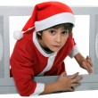 Portrait of a kid in Santa Claus costume - Foto Stock
