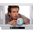 A 25 years old man behind a television screen is taking a little globe — Stock Photo