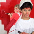 Children painting wall in red — Stock Photo #10378541