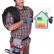Tradesman pointing to an energy efficiency rating chart — Stock Photo #10378804