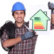 Electriciholding energy consumption label — Stock Photo #10378812