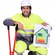 Construction worker with an energy rating symbol — Stock Photo #10378840
