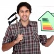 Stock Photo: Mholding calipers and information about energy efficiency