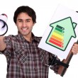 Man holding megaphone and electrical efficiency banner - Stock Photo
