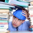 Stock Photo: Architect surrounded by piles of paperwork