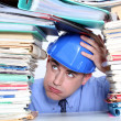 Foto Stock: Architect surrounded by piles of paperwork