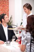 Waitress serving customers — Stock Photo