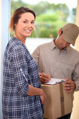 Woman receiving package — Stock Photo