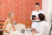 Couple ordering food in restaurant — Stock Photo