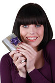 Young woman happy holding gift — Stock Photo