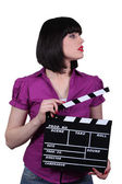 Attractive woman with a clapperboard — Stock Photo