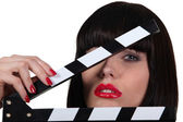 Attractive woman with a film set clapboard — Stock Photo