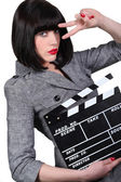 Take two: Girl with a film clapperboard — Stock Photo