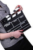 Woman holding clapboard on white background — Stock Photo