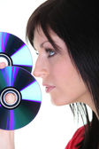 A brunette woman and discs — Stock Photo
