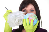 A charwoman cleaning a globe — Stock Photo
