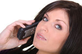 Brunette making telephone call — Stock Photo
