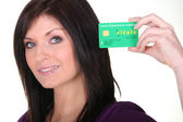 Woman showing French Carte Vitale — Stock Photo