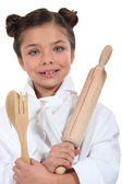 Girl pretending to be a cook — Stock Photo