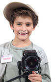 Young boy dressed as a press photographer — Stock Photo