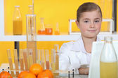Little girl conducting experiment — Stock Photo