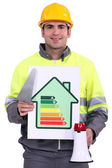 Builder with an energy efficient sign — Stock Photo