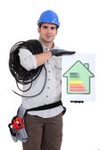 Tradesman holding an energy efficiency rating chart — Stock Photo