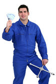 Mechanic with money — Stock Photo