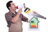 Handyman encouraging to be energy efficient — Stock Photo